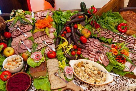 Catering table for a party. Meat and sausage.