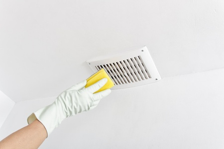 Hand cleaning ceiling.