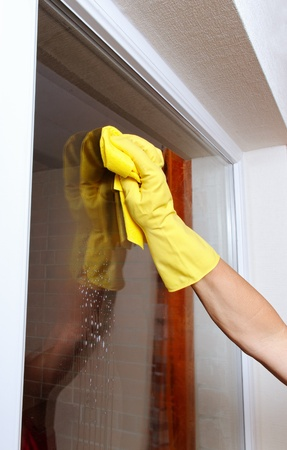 Hand cleaning window. Stock Photo