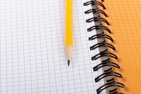 Pencil and notebook. Stock Photo - 10350437