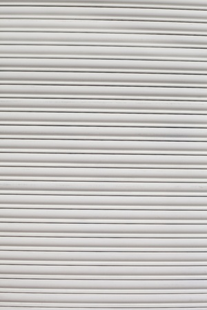 rolling garage door: White metalic shutter. Stock Photo