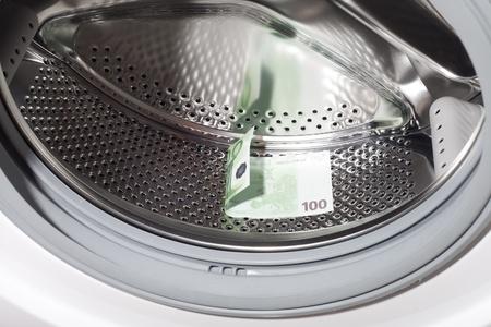 Money in washing machine . photo