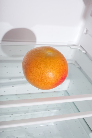 Grapefruit in fridge. photo