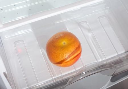 Grapefruit in fridge. photo