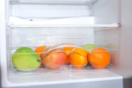 Fruits in fridge. photo