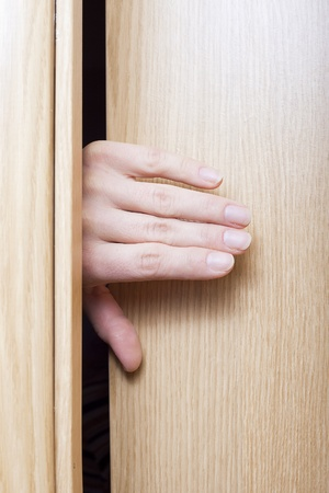 Hand opening the door. photo
