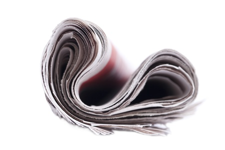 Rolled up newspaper isolated on white background. photo
