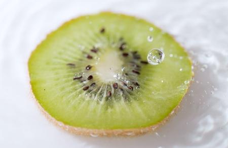 Slice of kiwi in water. photo
