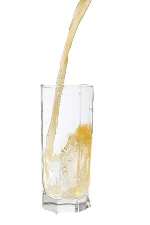 Pouring orange juice isolated on white. Stock Photo - 12184376