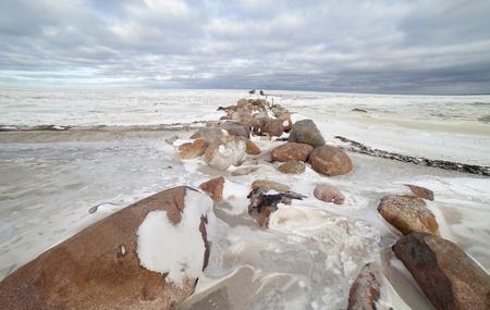 breakwater: Ruins of breakwater in winter  Stock Photo