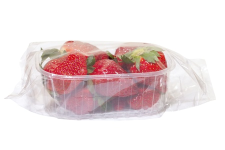 Strawberries in plastic box isol;ated on white Stock Photo - 13119980