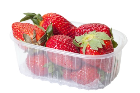 Strawberries in plastic box isol;ated on white  photo
