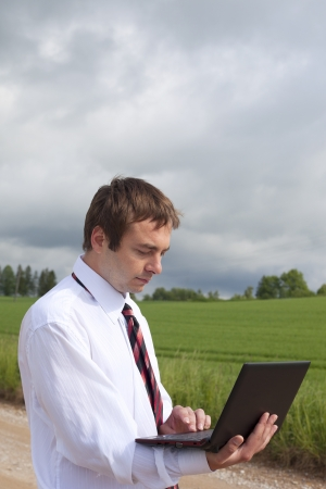Farmer calculating earning in field  photo