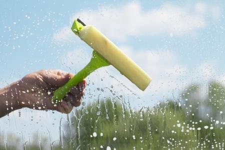 Human hand cleaning window