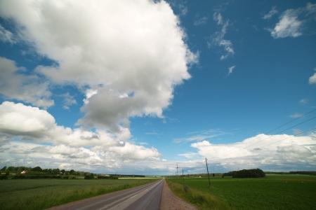 Wet road after rain in Zemgale, Latvia, Europe  photo
