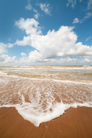 Waves on sand at Baltic  sea coast  photo