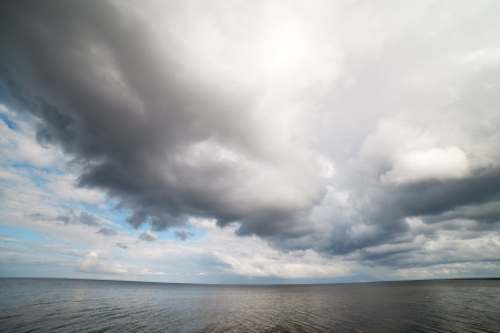 Big and dark cloud over sea  photo