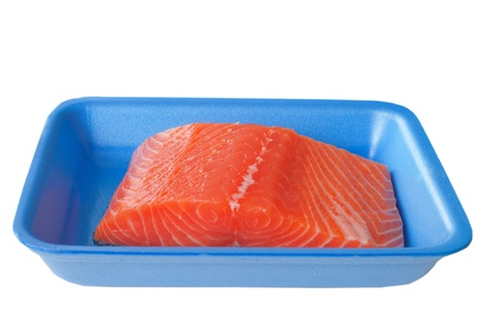 Salmon fillet in blue box isolated on white Stock Photo - 14972404
