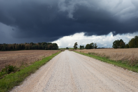 Gravel road under cloudy sky  photo