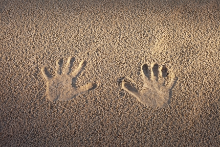 Hand prints in sand  photo