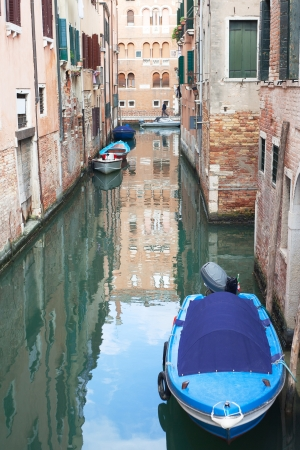 Boats in Venice canal, Italy  photo