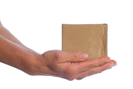 Cardboard box in hands isolated on white  photo