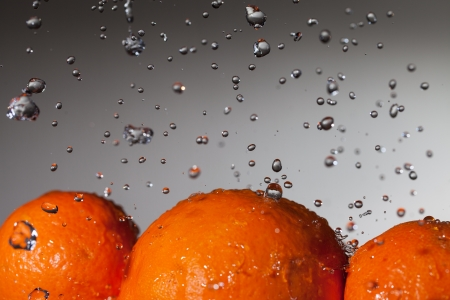 Water drops over ripe oranges  photo
