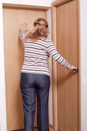 Closed doors and active wooman  Stock Photo - 17232866