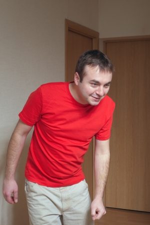 Young man and red shirt  photo
