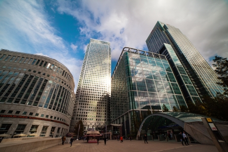 wharf: Clouds over skyscrapers in London Docklands financial district, United Kingdom