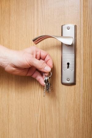 Hand and door  photo