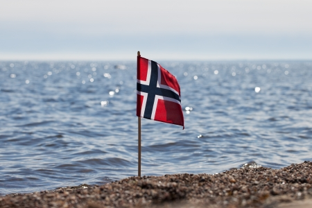 Norway flag at norwegian coast  photo