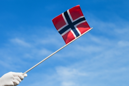 Norway flag in gloved hand  photo