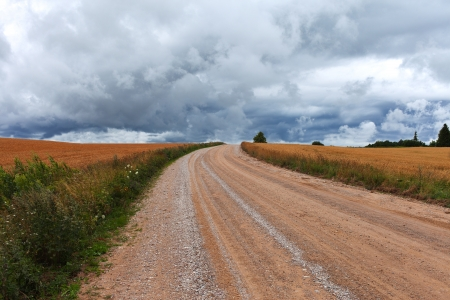Dark clouds over rural road. photo