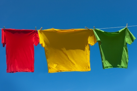 Color shirts on clothesline against blue sky. photo