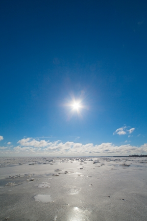 Winter sun and frozen Baltic sea. photo