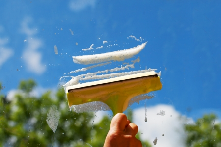 Cleaning of window in nice summer day. photo