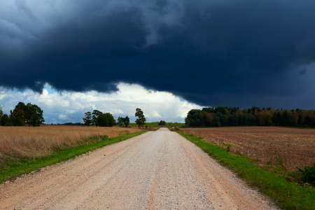 Clouds over empty rural road. photo