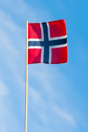 Norwegian flag against blue sky. photo