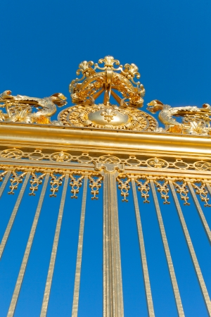 Golden gate of Versailles palace, France.