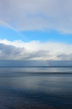 Rainbow over Baltic sea. photo