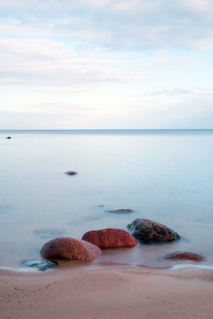 Stones in Baltic sea at latvian coast. photo