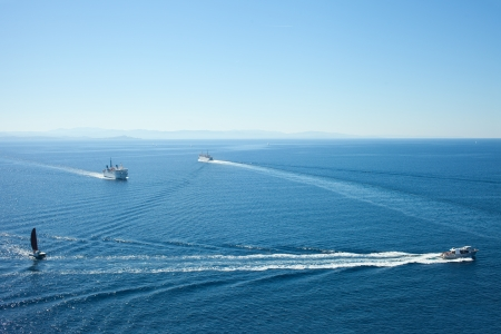 Ships in strait of Bonifacio between Corsica and Sardinia, Mediterranean sea. photo