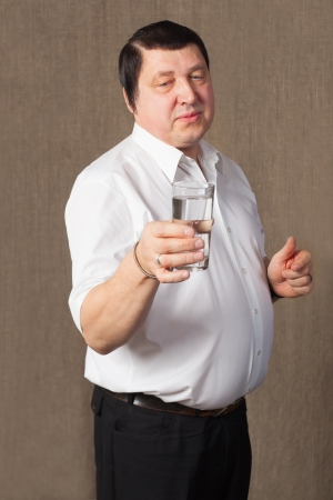 Man with glass of water. photo
