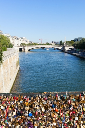 Archbishops Bridge and padlocks on Seine river in Paris, France.