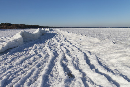 Ice at Baltic sea coast in winter. photo