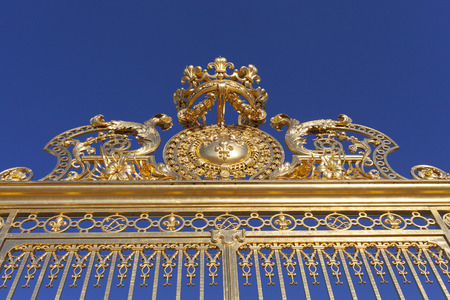 Top of golden gate, Versailles palace, France.