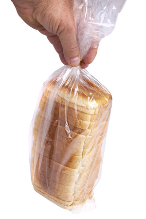Bread in plastic bag isolated on white background