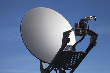 satelite: Satelite dish against blue sky.