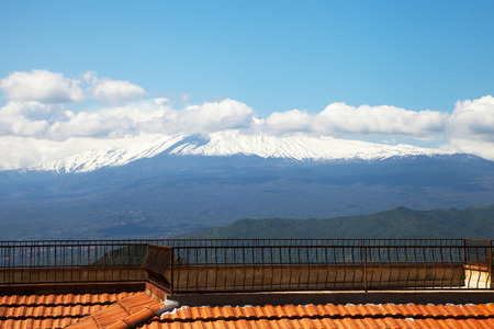 View to Etna volcano from Castelmola city, Sicily, Italy. photo